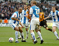 Photo: Ed Godden.<br />Wolverhampton Wanderers v Sheffield Wednesday. Coca Cola Championship. 25/03/2006. <br />Jeremie Aliadiere (C) is sandwiched between the Wednesday defence.