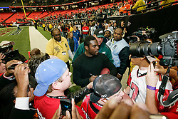 Philadelphia Eagles quarterback Michael Vick #7 signs autographs before the NFL game between the Philadelphia Eagles and the Atlanta Falcons on December 7th 2009. The Eagles won 34-7 at The Georgia Dome in Atlanta, Georgia. (Photo By Brian Garfinkel)