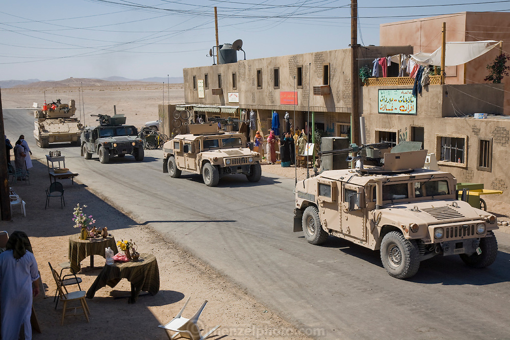 Military vehicles patrol the streets of Medina Wasl, a fabricated Iraqi town used for training Iraq-bound soldiers at Camp Irwin, California, in the Mojave Desert.