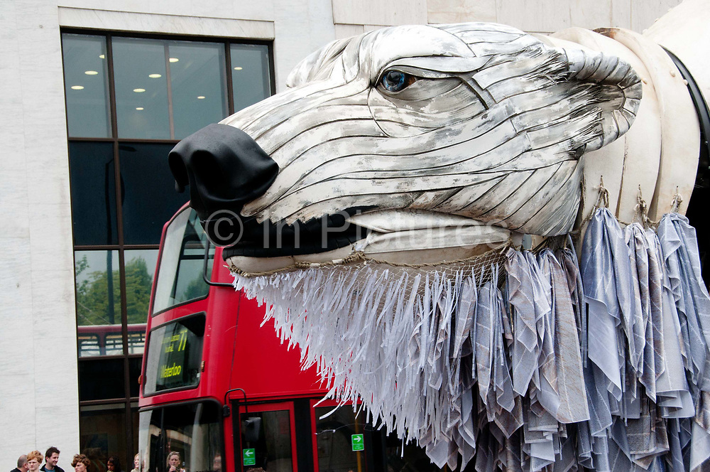 Outside the HQ of Shell , Waterloo, London, England UK. September 15th 2013. Aurora, the double-decker-bus-size polar bear puppet specially commissioned by Greenpeace to lead an Arctic-inspired street parade . The three-tonne marionette bear is operated from the inside by a team of 15 puppeteers,  and  hauled on ropes by 30 volunteers along a route from Victoria Gardens to Shell's HQ at Waterloo. The giant bear, which is made of replica and reclaimed ship parts as well as recycled materials, carries in her fur the names of over 3 and half million people who have joined the global movement to protect the Arctic from industrial exploitation. This parade  was part of a global day of action to protect the Arctic with tens of thousands of people taking to the streets in over 70 cities worldwide.