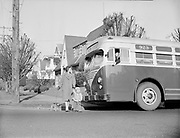 Y-480122-07. 39th Ave bus, corner pavement marked Knott St., January 22, 1948