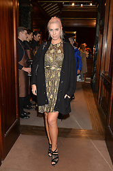 AMBER LE BON at the opening of the exhibition 'My Mother Was A Reeler' at Etro, 43 Old Bond Street, London on 5th October 2016.