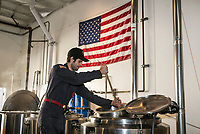 Chris Enegren stirs the mash while it heats up at Enegren brewery in Moorpark, CA. March 14, 2014. Photo by David Sprague