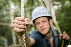 teenager in a climbing crag, close-up