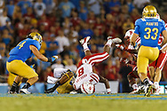 Ameer Abdullah #8 in his first career start, in place of an injured Rex Burkhead, in a 36-30 loss at UCLA's Rose Bowl on Sept. 8, 2012.