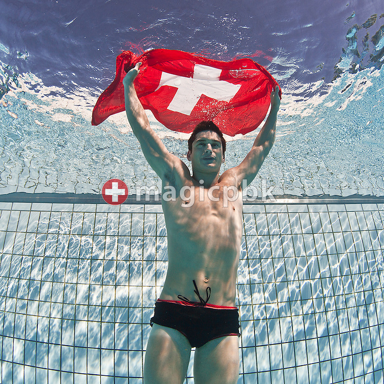 Stefan SIGRIST of Switzerland is pictured with a Swiss flag during an under water photo session in Tenero, Switzerland, Saturday, July 31, 2010. (Photo by Patrick B. Kraemer / MAGICPBK)
