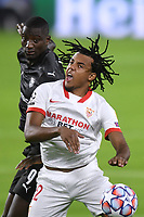 SEVILLE, SPAIN - OCTOBER 28: Jules Kounde of FC Sevilla and Sehrou Guirassy of Stade Rennais during the UEFA Champions League Group E stage match between FC Sevilla and Stade Rennais at Estadio Ramon Sanchez-Pizjuan on October 28, 2020 in Seville, Spain. (Photo by Juan Jose Ubeda/ MB Media).