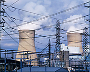 Transformers, power lines and cooling towers of Appalachian Power's John E. Amos coal-fired power plant on shore of the Kanawha River, West Virginia.