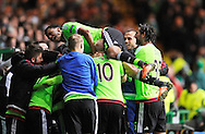 Ajax's Jairo Riedewald jumps on top of his celebrating teammates celebrate  Vaclav Cerny winner in a 1-2 victory versus Celtic during the UEFA Europa League Group A football match between Celtic and Ajax Amsterdam at Celtic Park, in Glasgow, Scotland on November 26, 2015.   AFP PHOTO / NEIL HANNA