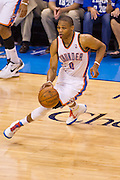 June 2, 2012; Oklahoma City, OK, USA; Oklahoma City Thunder guard Russell Westbrook (0) dribbles the ball during a playoff game against the San Antonio Spurs at Chesapeake Energy Arena.  Thunder defeated the Spurs 109-103 Mandatory Credit: Beth Hall-US PRESSWIRE