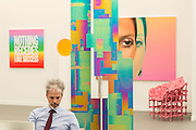 A man minds the booth of the Almine Rech Gallery.