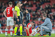 Arsenal midfielder Granit Xhaka (34) receives medical attention during the Europa League match between Arsenal and Eintracht Frankfurt at the Emirates Stadium, London, England on 28 November 2019.
