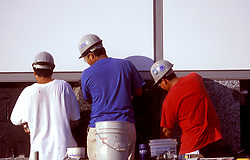 Stock photo of workers installing exterior panels during new construction at George R. Brown Convention Center in Houston, Texas