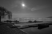 Varese. Lombardia. ITALY. General View. as the sun rises, and burns of the mist/fog at the Varese Rowing Club. [Canottieri Varese]<br /> <br /> Thursday  22/12/2016<br /> <br /> [Mandatory Credit; Peter Spurrier/Intersport-images] , Atmospheric, mist, fog, Sunrise, Sunset, Blue Hour,