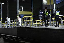© Licensed to London News Pictures . 01/01/2019 . Manchester, UK. Crime Scene Investigators work at the scene on Metrolink platform B at Victoria Station . Police have closed off Victoria Station in Manchester after several people were stabbed , including a British Transport Police officer , in a knife attack last night (Monday 31st December 2018). A man was arrested after a taser was deployed at the scene . Photo credit: Joel Goodman/LNP