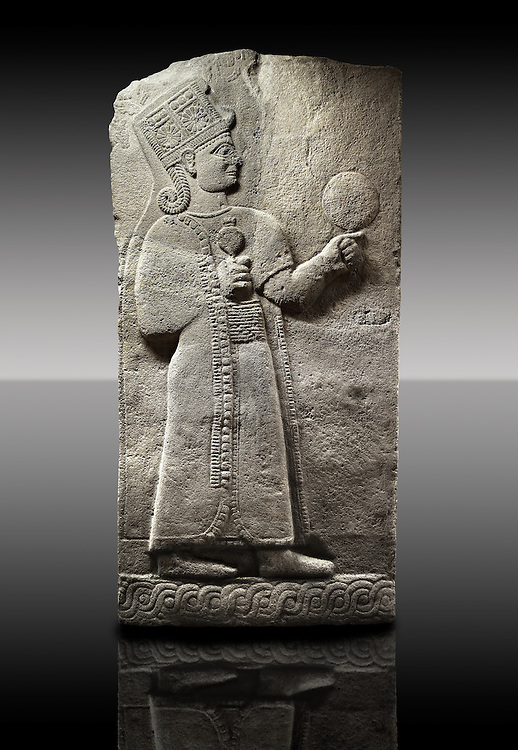 Picture & image of a Neo-Hittite orthostat showing a releif sculpture  of the Goddess Kubaba from Karkamis,, Turkey. Museum of Anatolian Civilisations, Ankara. 3 In her right hand she is holding a pomegranate