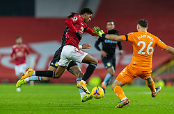 MANCHESTER, ENGLAND - Friday, January 1, 2020: Manchester United's Marcus Rashford is intercepted by Aston Villa's goalkeeper Emiliano Martínez during the New Year's Day FA Premier League match between Manchester United FC and Aston Villa FC at Old Trafford. The game was played behind closed doors due to the UK government putting Greater Manchester in Tier 4: Stay at Home during the Coronavirus COVID-19 Pandemic. (Pic by David Rawcliffe/Propaganda)