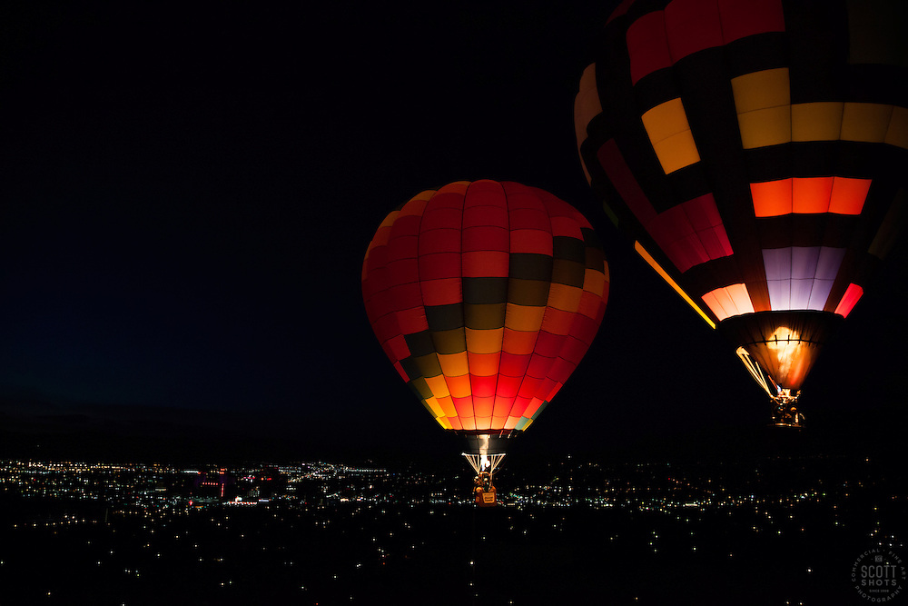 """""""Dawn Patrol 10"""" - Photograph of glowing hot air balloons flying for the Dawn Patrol at the 2012 Great Reno Balloon Race. Photographed from a hot air balloon."""