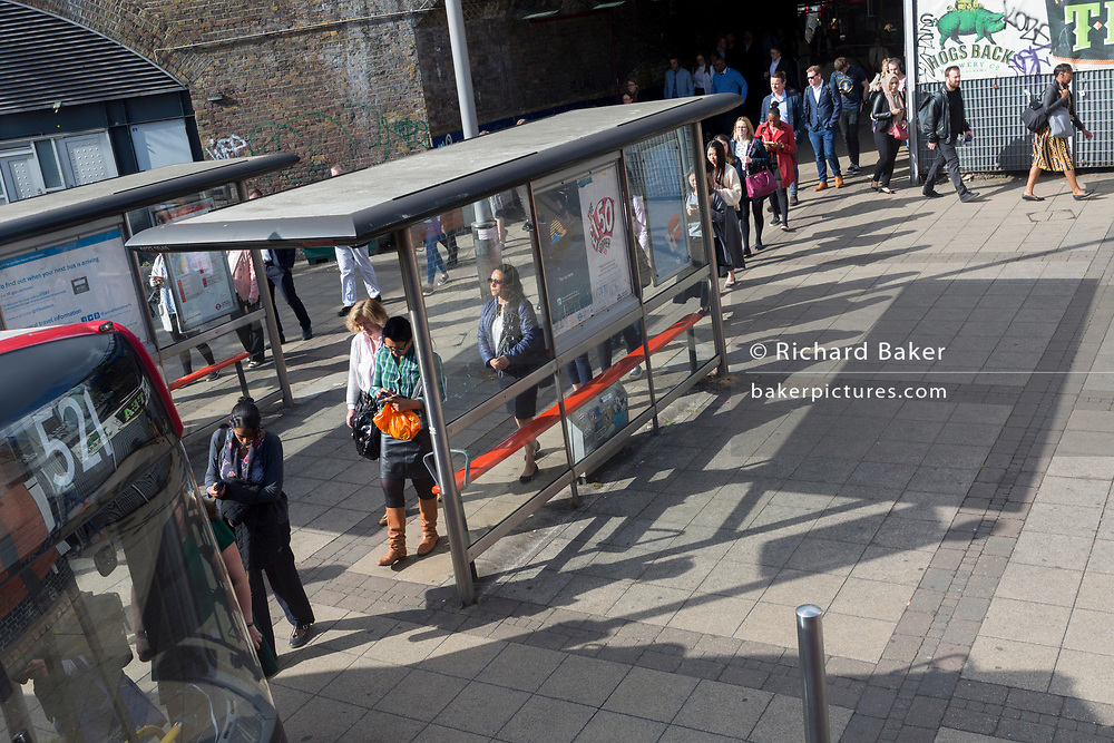 A queue of bus passengers wait for the next service at Waterloo Station during the morning rush-hour, on 5th June 2019, in London, England.