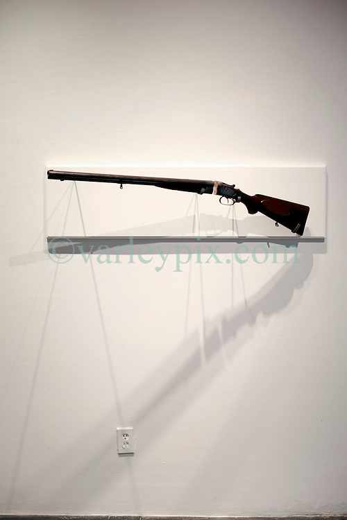 02 October 2014. Jonathan Ferrara Gallery, New Orleans, Louisiana. <br /> Jonathan Ferrara Gallery. 'Guns In The Hands Of Artists' A piece by the artist Adam Mysock. The show brings together over 30 internationally acclaimed artists who took parts from 190 destroyed weapons acquired by the New Orleans Police department  and converted them into art.  <br /> Photo; Charlie Varley/varleypix.com