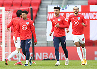 TIRANA, ALBANIA - MARCH 28: Jesse Lingard [left] Ollie Watkins [centre] and Dominic Calvert-Lewin [right] of England warming up before the FIFA World Cup 2022 Qatar qualifying match between Albania and England at the Qemal Stafa Stadium on March 28, 2021 in Tirana, Albania. Sporting stadiums around Europe remain under strict restrictions due to the Coronavirus Pandemic as Government social distancing laws prohibit fans inside venues resulting in games being played behind closed doors (Photo by MB Media)