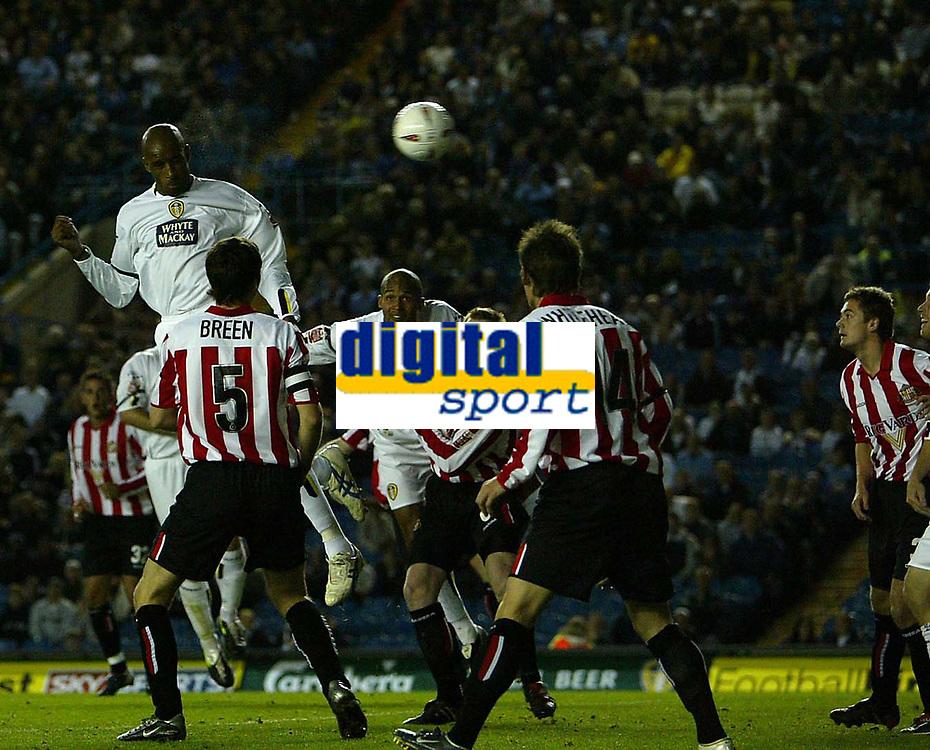 Photo. Andrew Unwin.Digitalsport<br /> Leeds United v Sunderland, Coca-Cola Championship, Elland Road, Leeds 24/09/2004.<br /> Leeds' Brian Dene (L) heads home but the goal is disallowed by the referee, Mr M Ryan.