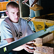 Bricklaying student building a wall.