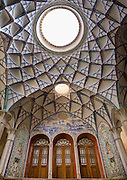 Stunning photographs reveal the beautiful ceilings in Iran's mosques, bazaars and public baths<br /> <br /> For the past few decades, restrictions on travel to Iran has meant the country has been largely shut off from the Western world, butas visa sanctions are lifted in the light of a landmark nuclear deal, the local tourism industry is hoping for a flurry of visitors.<br /> It's not hard to see why Iran is listed as one of the top travel destinations of 2016, with its rich culture and history.<br /> Among the standout aspects of the nation is its beautiful ancient architecture, with the cities and towns littered withornate and eye-catching mosques, public baths and markets.<br /> And unlike many other countries - the roof is not an afterthought, with many ceilings built as the centrepiece to the building, with many of the tile designs showcasing a display of intricate geometric patternsthatdate back several centuries.<br /> French photographerEric Lafforgue has travelled the country photographing the ceilings of indoor markets, mosques and bath houses.<br /> <br /> Photo shows: Ceiling With Its Intricate And Elaborate Patterns In Sultan Amir Ahmad Bathhouse Ceiling