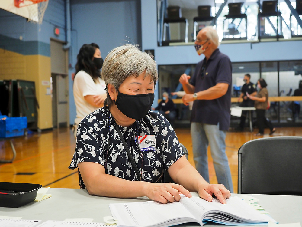 Voters in the Commonwealth of Massachusetts turned out in record numbers with absentee ballots as well as in person during early vote and on Primary Day. An election worker checks her book to make sure a voter has not already voted.