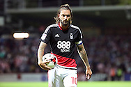 Nottingham Forest midfielder Henri Lansbury (10)  holding ball during the EFL Sky Bet Championship match between Brentford and Nottingham Forest at Griffin Park, London, England on 16 August 2016. Photo by Matthew Redman.