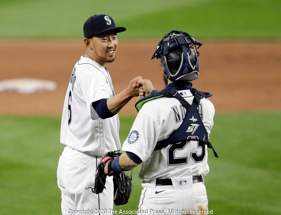 Seattle Mariners' Yoshihisa Hirano and catcher Austin Nola celebrate the 10-1 win over the Texas Rangers of a baseball game, Saturday, Aug. 22, 2020, in Seattle. (AP Photo/John Froschauer)