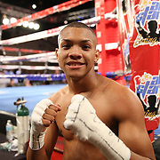 Joshua Santos  celebrates his win over Ricky Tomlinson during a Telemundo Boxeo boxing match at the A La Carte Pavilion on Friday,  March 13, 2015 in Tampa, Florida.  Santos won the bout after Tomlinson's corner stopped the fight in the first round. (AP Photo/Alex Menendez)