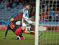 Nahki Wells of Huddersfield Town (right) scores the 2nd goal against Reading during the Sky Bet Championship match at the John Smiths Stadium, Huddersfield<br /> Picture by Graham Crowther/Focus Images Ltd +44 7763 140036<br /> 03/01/2015
