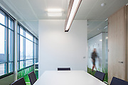 london office interior green carpet glass wall