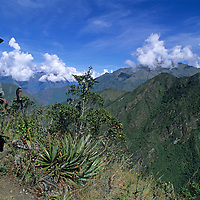 A villager surveys the deep canyons and steep ridges of the Cordillera Vilcabamba in the Cusco District of the Peruvian Andes.