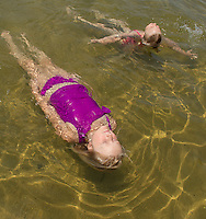 Cooling off at the beach.  Karen Bobotas/for the Laconia Daily Sun