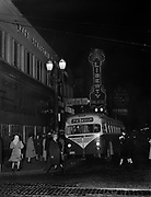 Y-480200-01. Night view of 72nd Mississippi bus on SW Broadway at Washington. Notice the cobblestones and trolley tracks in Washington St. Liberty Theatre, Benson Hotel and Blitz Weinhard sign in background. 1948 license plate. Published on February 25, 1948 in PTCo. advertisement. February, 1948 photo.