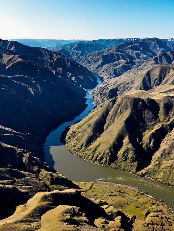 Aerial view of Hells Canyon in Spring time upriver (South from Lewiston / Clarkston about 30 miles. Idaho Washington Border. Licensing and Open Edition Prints.