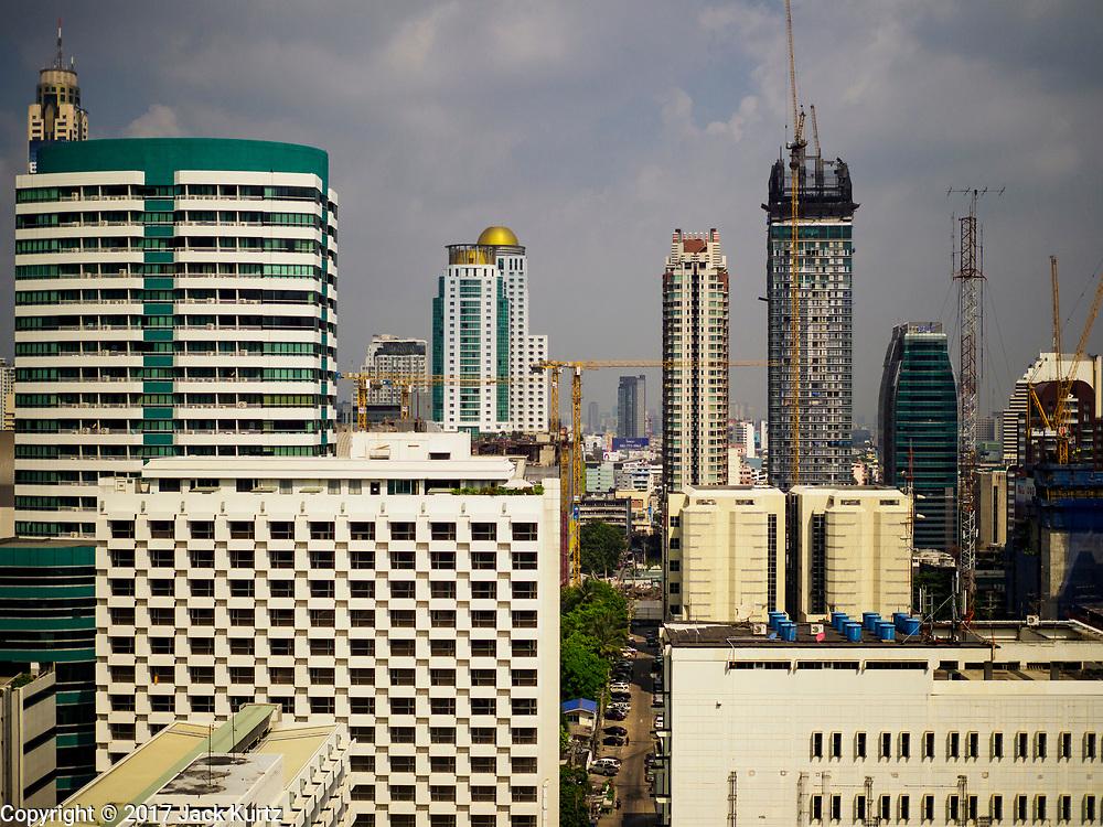 13 DECEMBER 2017 - BANGKOK, THAILAND: The Bangkok skyline from Chit Lom with a mixed use skyscraper under construction.     PHOTO BY JACK KURTZ