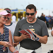 Driver Tony Stewart walks in the pit area during the first practice session of the 56th Annual NASCAR Coke Zero400 race at Daytona International Speedway on Thursday, July 3, 2014 in Daytona Beach, Florida.  (AP Photo/Alex Menendez)