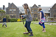 Playing croquet in the garden at Pickwell Manor. From left to right: Milly-grace (8), Molly Elliott (10), Liza Baker (9). Pickwell Manor, Georgeham, North Devon, UK.<br /> CREDIT: Vanessa Berberian for The Wall Street Journal<br /> HOUSESHARE