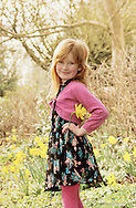 Sassy girl with daffodils in springtime