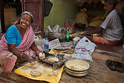 Family stall making chapatis on the street 28th February 2018 in Kochi, Kerala, India. Chapati is a type of Indian flat bread, its very popular in India. It is a staple and made of really simple ingredients: wheat flour, salt and water.
