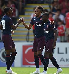 Arsenal's Pierre-Emerick Aubameyang celebrates scoring their first goal during the pre-season match at Meadow Park, Boreham Wood.