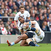 Barbarians centre Joe Rokocoko (Bayonne & New Zealand) is brought to ground by England No.8 Josh Beaumont (Sale Sharks) during the International Rugby Union match England XV -V- Barbarians at Twickenham Stadium, London, Greater London, England on May  31  2015. (Steve Flynn/Image of Sport)