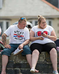 @ Licensed to London News Pictures. 14/07/2013. <br /> People enjoying the continuing hot sunny weather on the beach at the seaside resort of Aberystwyth on the Cardigan Bay coast, West Wales UK. Temperatures in the UK have broken 30 degrees celsius this weekend. Photo credit: Keith Morris/LNP