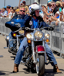 June 3, 2017 - Boone, Iowa, U.S - United States Vice President MIKE PENCE rides a Harley motorcycle into Senator Joni Ernst's 3rd annual Roast and Ride charity benefit at the Central Iowa Expro center. (Credit Image: © Mark Reinstein via ZUMA Wire)