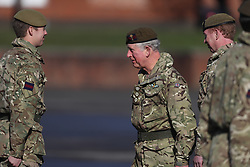 The Prince of Wales (centre) talks with soldiers from the 1st Battalion Welsh Guards at Elizabeth Barracks in Woking, following their return from Afghanistan as he presents them with their campaign medals.