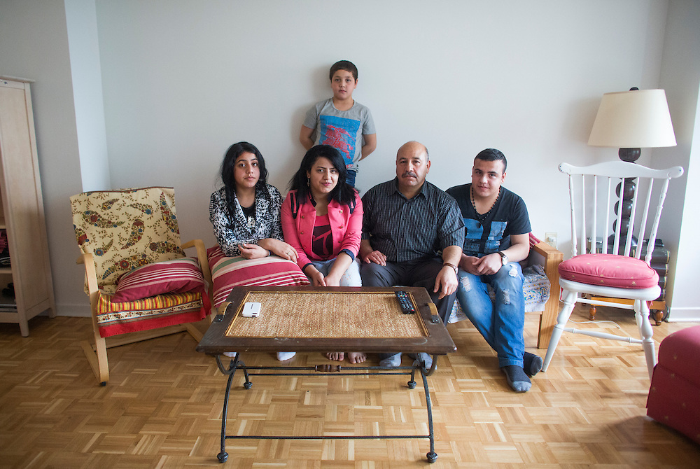 The Al Hasan family (left to right), Rania (L), Fusie, Nasimi, Batal, and Ali who are Syrian refugees, pose for a picture inside their apartment in Mississauga, Ontario, Canada, Thursday January 21, 2016.   (Mark Blinch for the BBC)