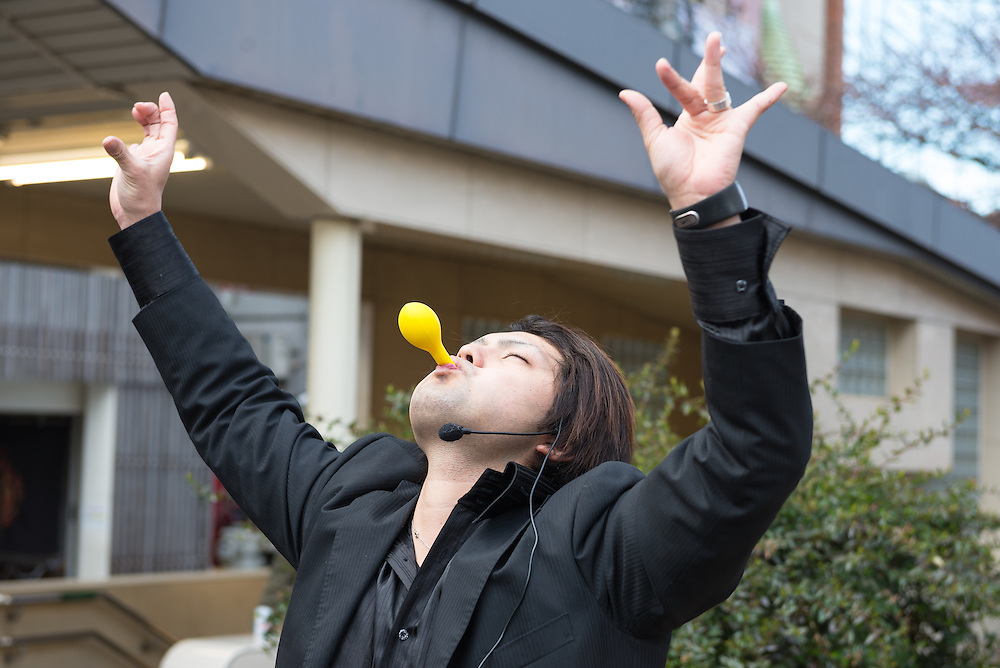 Magician busking in the Gion district of Kyoto, Japan